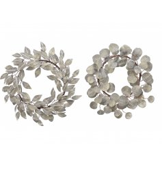 A simple yet stylish assortment of round Leaf Wreaths, each decorated with a frosty glitter covering