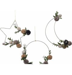 A gorgeously simple assortment of hanging wire shaped decorations, each complete with a leaf and pompom design