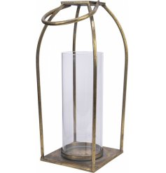 Perfect for placing in any home with a Rustic setting, a sleek and simple tarnished gold metal edge lantern