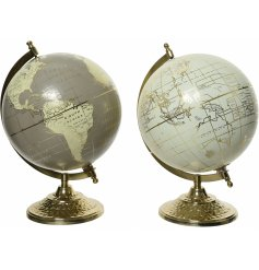 A assortment of Cashmere Brown and Wool White toned globes on Rustic Iron Stands