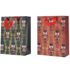 an assortment of festive themed gift bags with Nutcracker Prints and a glittery finish