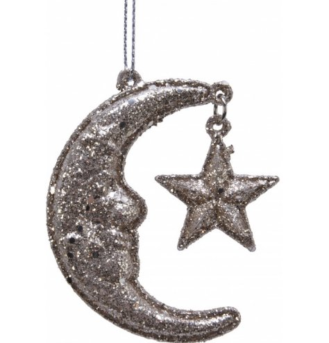 A hanging smiling moon with star attached and finished in a heavy dusting of glitter.