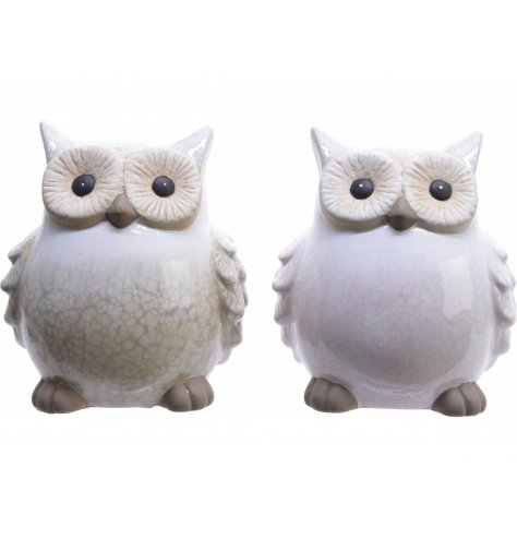 Smooth glazed neutral sitting owl ornaments made from terracotta.