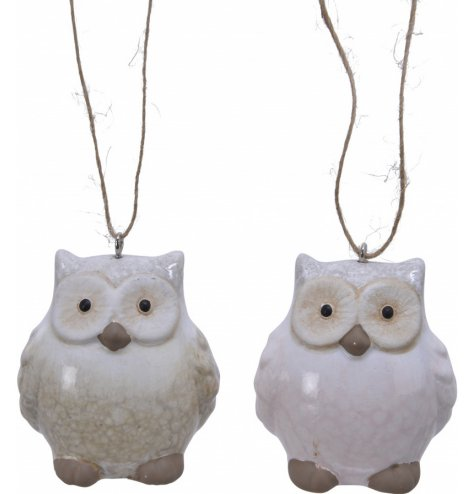 Smooth glazed neutral hanging owls made from terracotta.