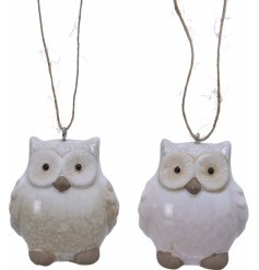 this mix of terracotta owl hangers have light beige and soft pink tones