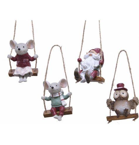 An assortment of cute characters wrapped up in winter scarves hung on a swing.