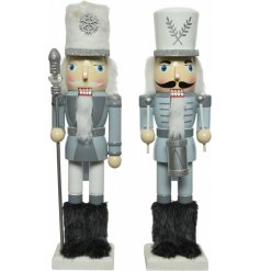 An assortment of wooden nutcrackers covered with silver glitter, soft grey tones and faux fur trimmings