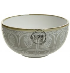 With its smooth glazing over an embossed snowflake print, this metallic rimmed bowl will be sure to place perfectly on
