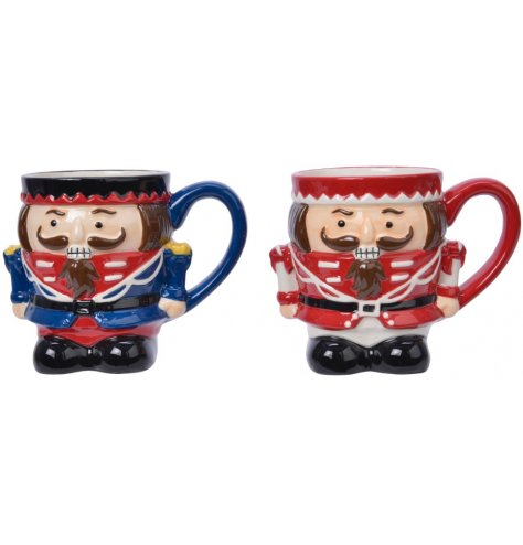 Two assorted novelty shaped nutcracker mugs.