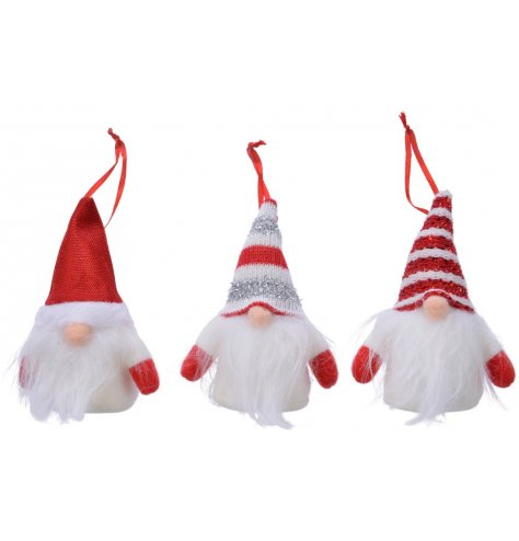 Three festive white and red hanging gnome decorations.