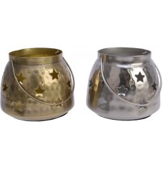 An assortment of Gold and Silver Hammered Candle Pots, each set with a cut star decal