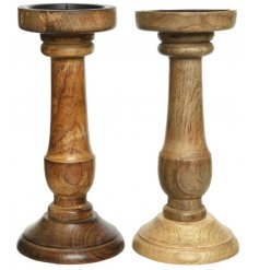 A sleek and simple assortment of Mango Wood Candle Stick Holders, each set with a soft natural wood grain finish