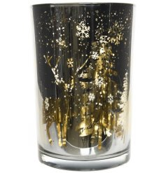 A gorgeously decorated glass candle holder with a smoked grey and golden lining