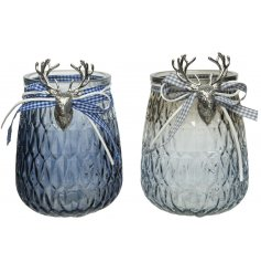 Assorted by their white and blue tones, these ridged candle pots feature silver reindeer busts and tied bow decal