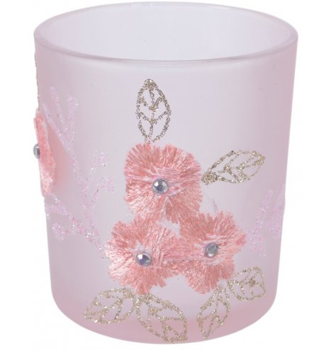 A blush pink frosted t-light holder with lace flower detail and glitter leaves.
