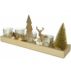 A large decorative wooden tray beautifully decorated with a range of festive themed accents and tlight holders