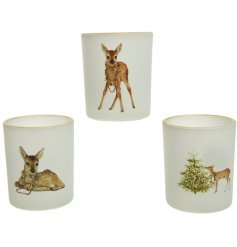 An assortment of sweetly printed glass candle pots decorated with a cute woodland decal decal on each
