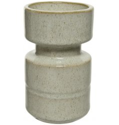 An sleek stoneware candle holder with an added smooth glaze finish