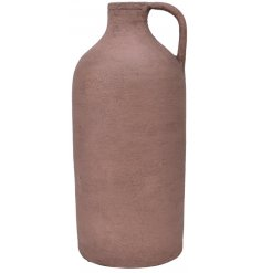 A stylish terracotta handled jug with a sanded blush pink tone to it