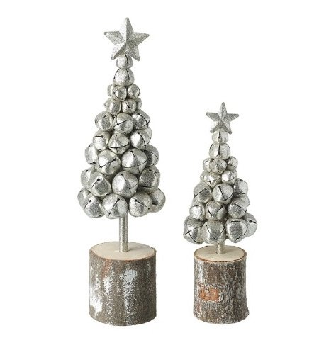 Silver metal bells in the shape of trees with star on top and wooden base.