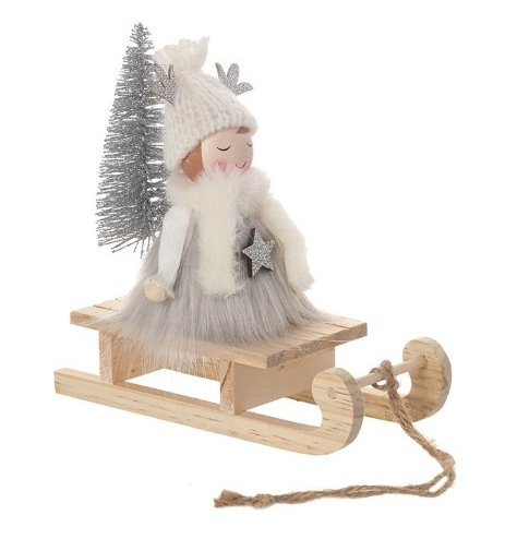 A beautiful wooden angel wrapped up warm in soft faux fur accessories for fun sledging.