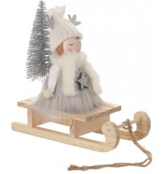 A delightful little Wooden Girl Decoration covered with soft faux fur and complete with glittery accents