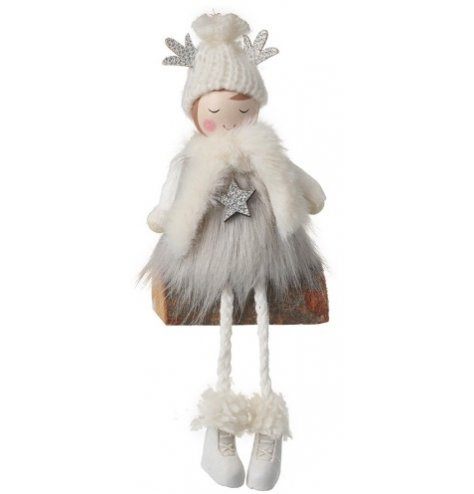A beautiful wooden angel wrapped up warm in soft faux fur accessories.