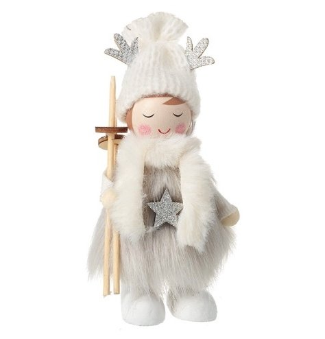 A beautiful wooden angel kitted out a soft faux fur accessories for a cold skiing session.