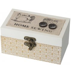 A natural wooden hinged box with added white decals and a charming sewing inspired print