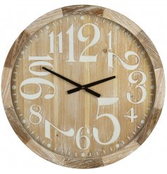 Decorated with its assorted sized numbers, this large wall clock will be sure to place perfectly in any home with a Rus