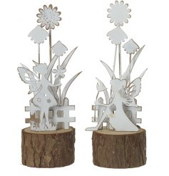 A mix of cut metal ornaments set ontop of natural bark bases
