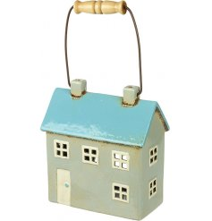 Perfect for adding a cosy feel to any home, a small house shaped ceramic tlight holder
