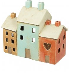 A small decorative Candle Holder set with a house inspired theme