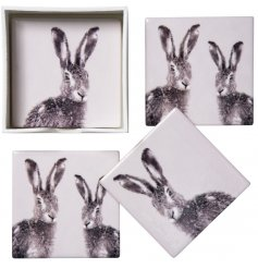 A sleek set of 4 ceramic based coasters, each printed with a charming hare decal