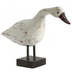 A standing duck ornament set with a distressed hand carved inspired decal