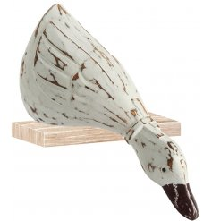 An ornamental duck set with a distressed hand carved inspired decal and shelf sitting pose