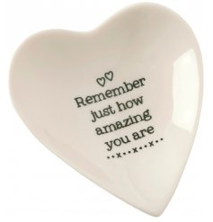A small heart shaped porcelain dish set with a bold scripted text decal in the centre