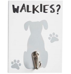 A white wooden plaque set with a printed dog decal and added silver hook