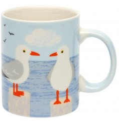 A sleek ceramic mug featuring blue hues and a seagull decal