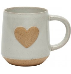 A sleek off white ceramic mug with a stone inspired heart decal and base trimming