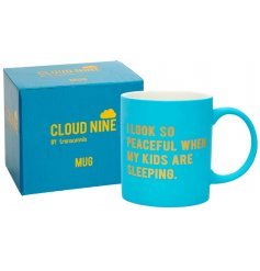 a bright blue toned mug with a comical scripted text in a gold setting