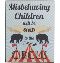 A quirky metal sign featuring a circus theme and bold scripted text