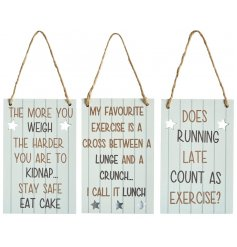 A mix of 3 cream toned hanging metal signs, each decorated with a humorous scripted text about exercise and weight