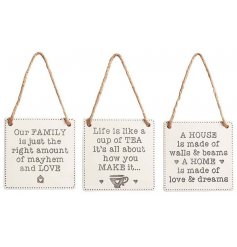An assortment of 3 hanging ceramic square plaques each decorated with its own homely texts
