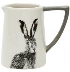 A decorative ceramic jug featuring a black and white printed hare decal