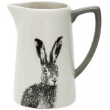 A large decorative ceramic jug featuring a black and white printed hare decal