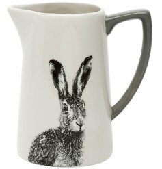 A grey and white toned ceramic jug featuring a black and white printed hare decal