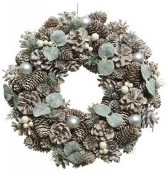 Covered with glittery foliage, pinecones, berries and baubles