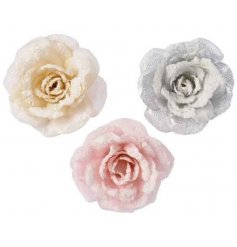 an assortment of 3 fabric roses with added glittery touches