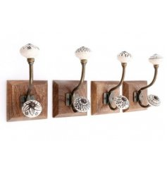 An assortment of natural wooden plaques featuring 4 beautifully decorated coat hooks